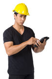 Solemn young foreman. Yellow hard hat Stock Images