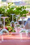 Solemnly laid table with wine glasses. Outdoor Royalty Free Stock Images