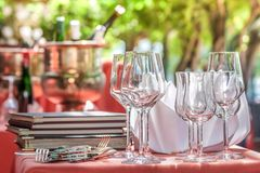 Solemnly laid table with wine glasses. Outdoor Stock Photography