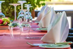 Solemnly laid table with wine glasses Royalty Free Stock Photo