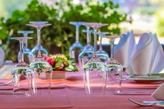 Solemnly laid table with wine glasses. Outdoor Stock Photo