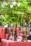 Solemnly laid table with wine glasses. Outdoor Royalty Free Stock Image