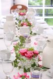 Solemnly laid wedding  table. Solemnly laid table for a wedding with white and pink Royalty Free Stock Photos