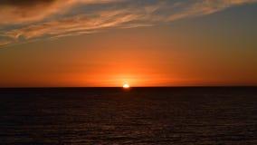 Solen ställde in med härlig färg arkivfoto
