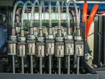 Solenoid valves with pipes. Solenoid valves with transparent plastic pipes and motor Stock Photography