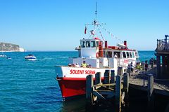 Solent Scene ship along Swanage pier. Royalty Free Stock Photo