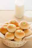 Solf bun with green custard stuff pile in basket Stock Photography