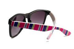 Solglasögon med ljusa multi-colored remsor Arkivbild