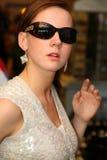 solglasögonkvinna arkivfoto