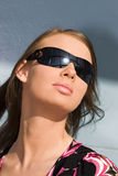 solglasögonkvinnabarn Royaltyfri Foto