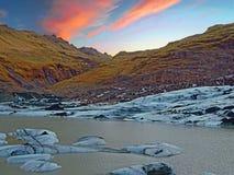Solheimajokull Glacier in Iceland at sunset Stock Photo