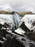 Solheimajokull Glacier, Iceland. Gray volcanic ash covers the ice on Solheimajokull glacier in southern Iceland Royalty Free Stock Photos
