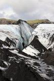 Solheimajokull Glacier, Iceland. Grey volcanic ash covers the ice on Solheimajokull Glacier in southern Iceland Stock Photos