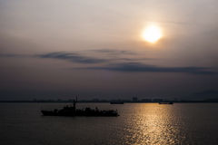Silhouette of navy ship on sunrise Stock Photography