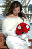 Solice Bride. Beautiful bride in snow looking down at her flowers Royalty Free Stock Images