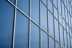 Solid blue windows of the office building. Glass wall.  stock photography