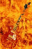 Burning Guitar On Fire Background. A solid body electric guitar burning in a inferno Stock Image