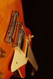 Solid body electric rock guitar closeup on black background. Selective focus. Royalty Free Stock Image