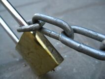 solid-brass-lock-and-chain Stock Photo