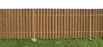 Solid fence. Solid long wooden yellow rural fence. Isolated with patch. Sunny summer day Royalty Free Stock Photo
