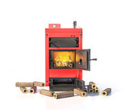 Solid fuel boiler with burning briquettes. Royalty Free Stock Photo