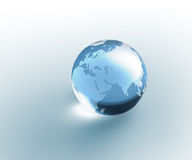 Solid glass globe Earth transparent stock image