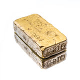 Solid gold bar reflected in mirror Royalty Free Stock Images