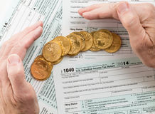 Solid gold coins on 2014 form 1040 Stock Images
