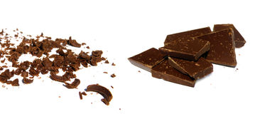 Solid and grated chocolate. A pile of solid and grated chocolate isolated on white Stock Photo