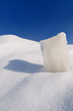 Solid ice cube, snowdrift and cloudless blue sky. Solid ice cube, snowdrift and cloudless  blue sky Royalty Free Stock Photo