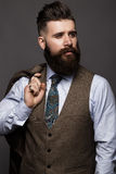 Solid man with beard and mustache in classic fashionable suit. Stock Photo