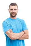 Solid man with crossed arms isolated background Stock Photo