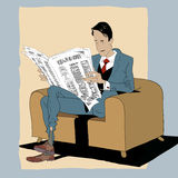 Solid man reading a newspaper Royalty Free Stock Photography
