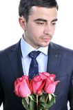 Solid man in a suit with roses. Royalty Free Stock Photos