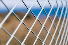 Solid metallic mesh fence Royalty Free Stock Photography