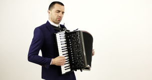 A solid musician plays the accordion in the studio. stock video footage