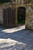Solid oak garden door with stone surround. Stock Photo