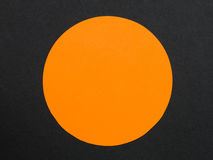 Solid Orange Disc or Circle Against a Black Background. With Copy Space royalty free stock image