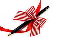 Solid Pen as a Gift with Red Bow Stock Image