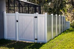 Solid Privacy Vinyl Fence. 6 feet  White Solid Privacy Vinyl Fence with gate around your house Stock Photo