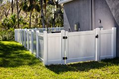 Solid Privacy Vinyl Fence. 4 feet  White Solid Privacy Vinyl Fence around your house Stock Photos