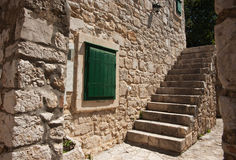 Solid Stone wall and steps. Royalty Free Stock Photo
