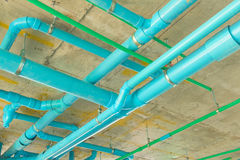Solid waste & sanitary PVC pipeline suspension. Solid waste & sanitary PVC pipeline suspension, Pipe installation Stock Images