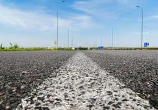 Solid white line on asphalt road closeup Stock Photos