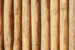 Solid wood backgroung texture of whole logs. Royalty Free Stock Photography