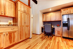 Solid wood birch kitchen custom made cabinets with hardwood floor. New Solid wood acasia kitchen custom made cabinets with hardwood floor. Large open space with stock images