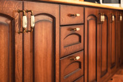 Solid wood kitchen furniture interior details Royalty Free Stock Photo