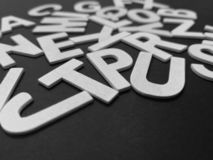 Solid wooden alphabet blocks with black color background. stock photos