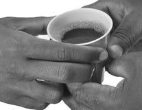 SOLIDARIDAD ALREDEDOR DE UN POTE DEL CAFÉ Imagenes de archivo