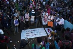 Solidarität für JJ ein Opfer des Vergewaltigens durch 14 Jungen in Indonesien Lizenzfreie Stockfotografie